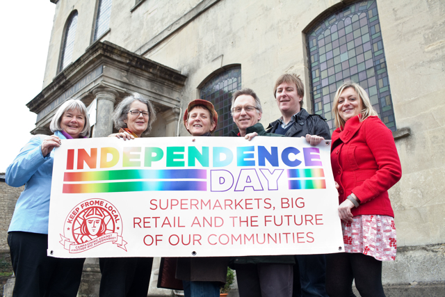 Flying the banner for Independence Day in Frome are (left to right) Janet Weeks, Sheila Gore, Dodie Stephens, Duncan Skene, John Harris, and Jennie Wood. Photo: Tim Gander